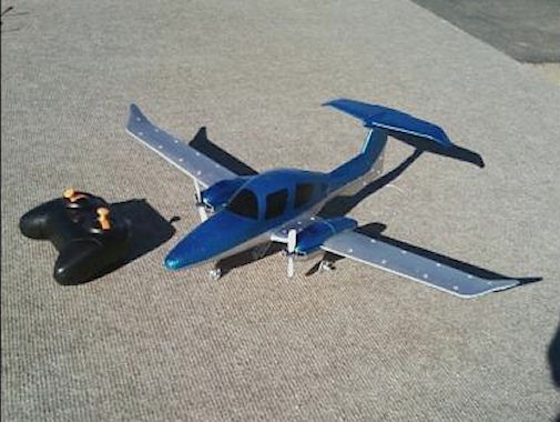 483-2 ounces, 20 inch span, motor control only - no conventional control surfaces.  IT FLIES !!